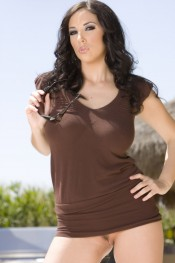 Beautiful busty brunette, Jelena Jensen, looks incredible in her tiny brown mini dress and high-heeled black boots, and even better stripping down to nothing but those boots!