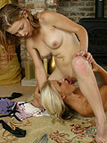 Picture perfect lesbian teens engage in erotic floor sex