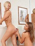 Strapon dildo slides into fresh pussy as girls make love