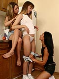 Three pretty lesbians taste fresh teen pussy in kitchen orgy