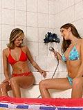 Showering lesbian licking her girlfriends erect clitoris