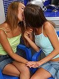 Tender brunette cuties kiss and dildo wet twats in kitchen
