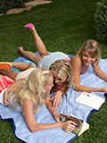 Watch three hot blondes eat pussy passionately in the garden