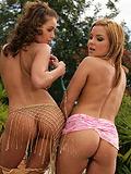 Blazing hotties in bikinis oil up smoking bodies outside