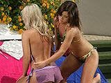 Captivating honeys pound tight pussies with strapon poolside