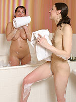 See innocent girlfriends share a bath then make love in bed