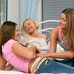 Playful teen trio fingers and dildos twats in bedroom romp