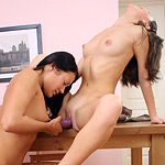 Cute brunette teens kiss and dildo pink pussies on table