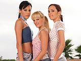 Three gorgeous vixens lustily rub and dildo twats outside