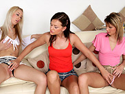 Tempting ladies lap and trib sweet twats in couch threesome