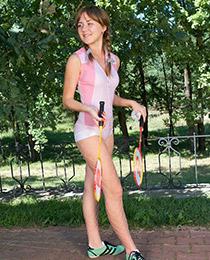 Teenie posing in the park