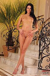 Brigitte Hunter fingering on stairs