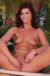 Sexy Megan posing naked outdoors