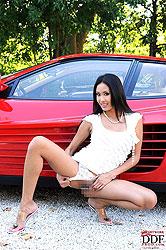 Exotic Danika posing with Ferrari