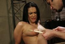 Brunette Carrmens enjoying her painful punsihment