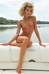 Skinny blonde babe Iona is anal fucked on a boat