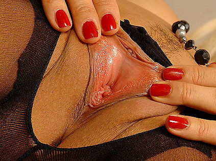 Sexy blonde Sandy masturbating in a red Ferrari