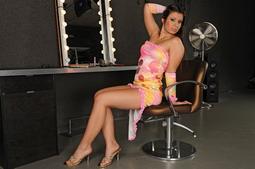 Hot brunette is stripper preparing her make-up