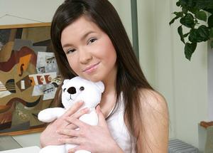 Hot asian teengirl is stripping and masturbating