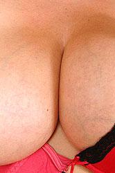 Busty Constance Devil strips nude