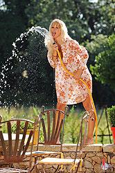 Nikita Valentin gets wet outdoors
