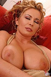 Busty Constance Devil masturbating