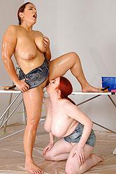 Busty lesbian couple having hot fun