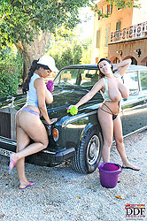Hot busty babes washing car naked