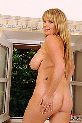 Hot busty Maggie Green in bathroom
