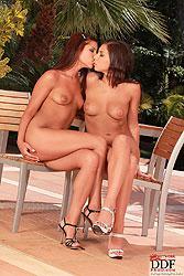 Tanned brunettes having lesbian fun