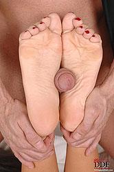 Sexy Melanie Memphis doing footjob