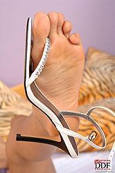 Sahara Knite licks her little toes!