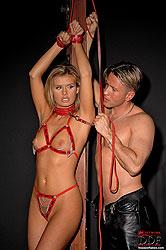Young blonde Cloe in bondage scene