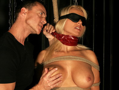 Hot blonde being painfully punished by her master