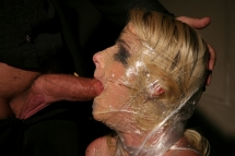 The creative master wrapped Anita Blue in plastic