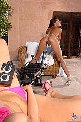 Yummy lesbians banged by a machine