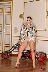 Eve Angel posing with a motorbike