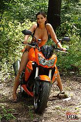 Sexy Eve Angel naked on motorbike