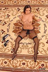 Eve Angel posing naked on carpet