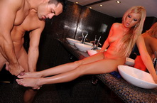 Blonde girl does footjob in night clubs baathroom