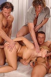 Busty blond Luba in 4 cock hardcore