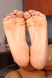 Sexy Amabella doing footjob on boss