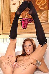 Lovely redhead wearing black socks