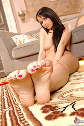 Sexy brunette in foot fetish action