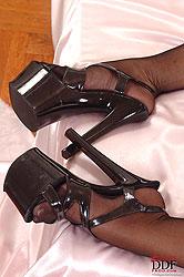 Dominatrix enjoys her foot slave