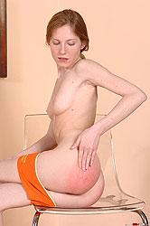 Redhead teenie spanked really hard