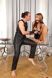 Satin Bloom gets spanked in latex