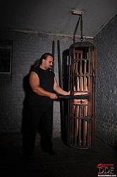 Bound naked Bianka spanked in cage