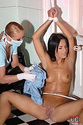 Nasty nurse makes bound babe pee