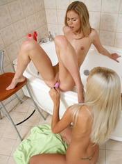 Hot lesbian teen girls having sex in the bathroom